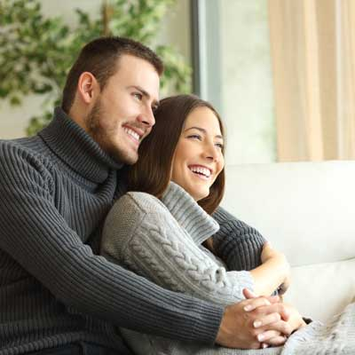 happy couple sitting on couch